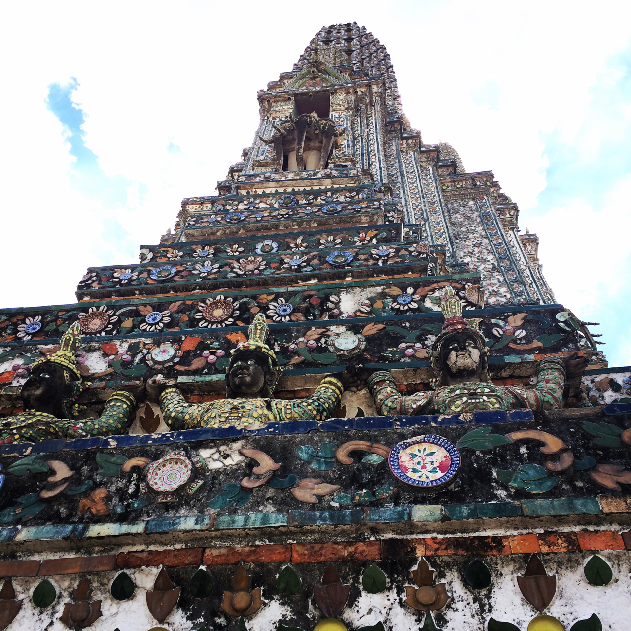 Temples in Bangkok, Wat Arun close up of the tiles and statues on the siding