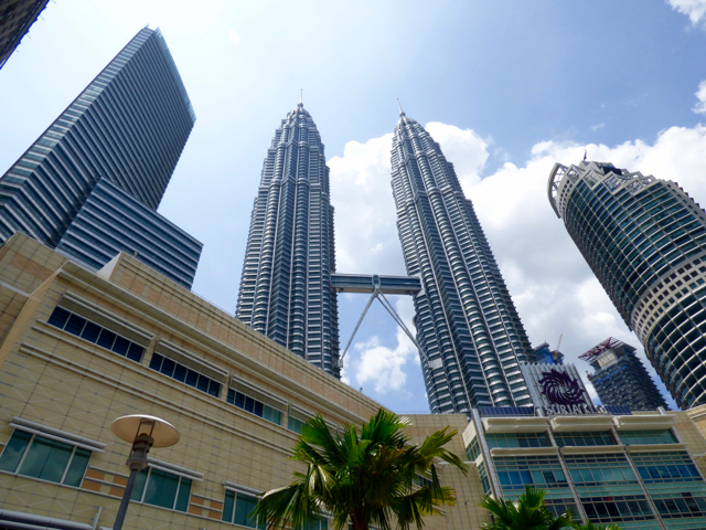 Looking up at the Petronas Towers, this icon is a prime Instagrammable spot in Kuala Lumpur