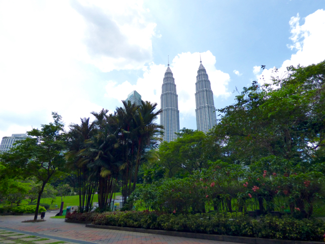 KLCC Park is very green with many plants and trees and play areas for children and paths to get some exercise in. Petronas Towers in the background