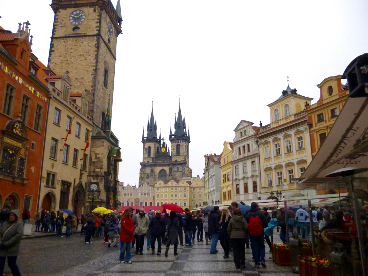 Old Town Square with cobblestones and tall, spikey architecture in many colors