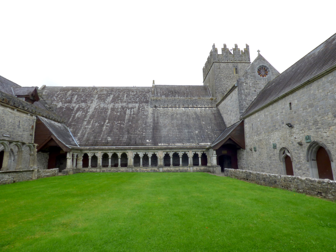 Holy Cross Abbey in Tipperary, Ireland from the outside with lawn