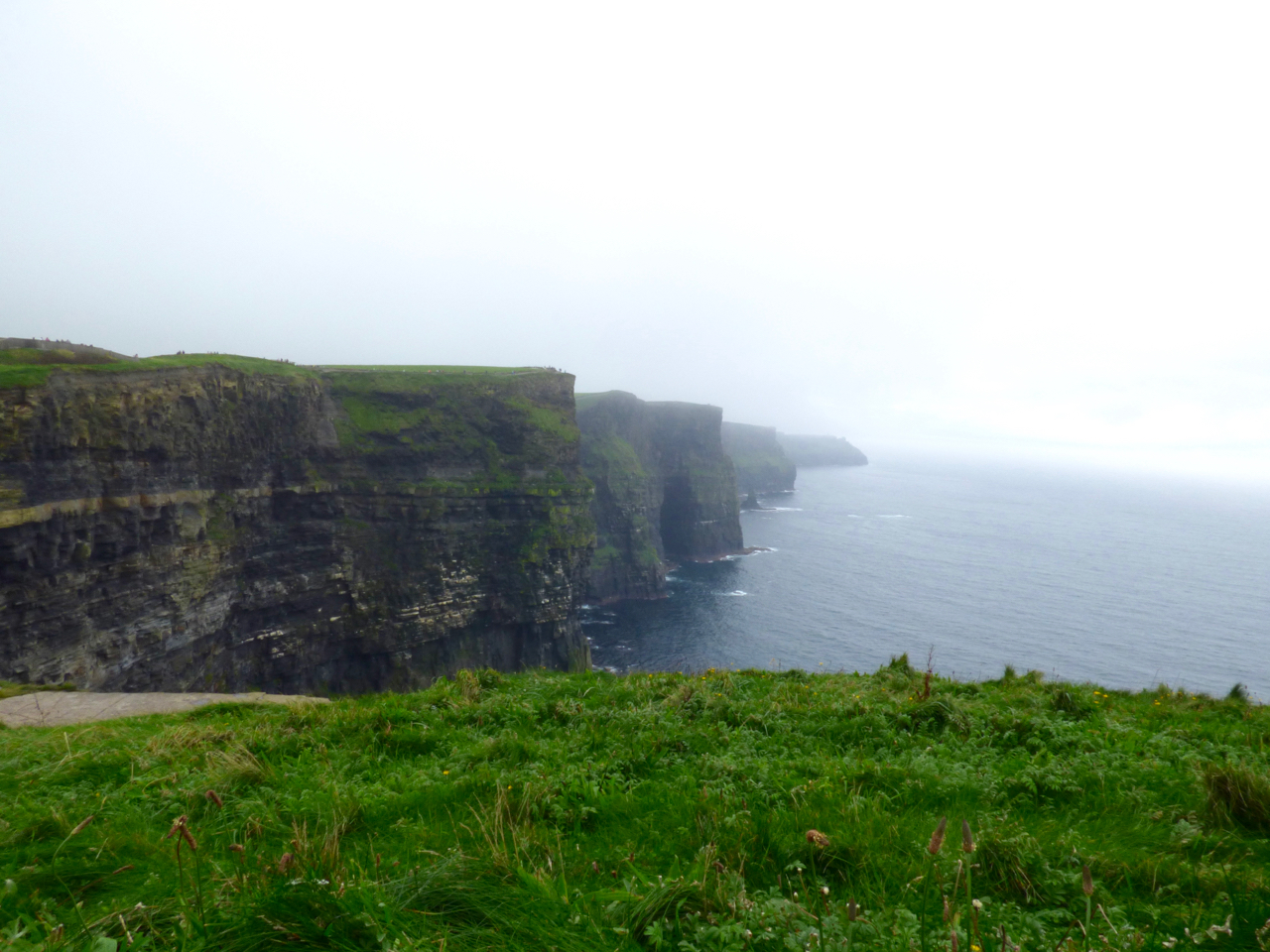 Cliffs of Moher Ireland shrouded in fog and mist