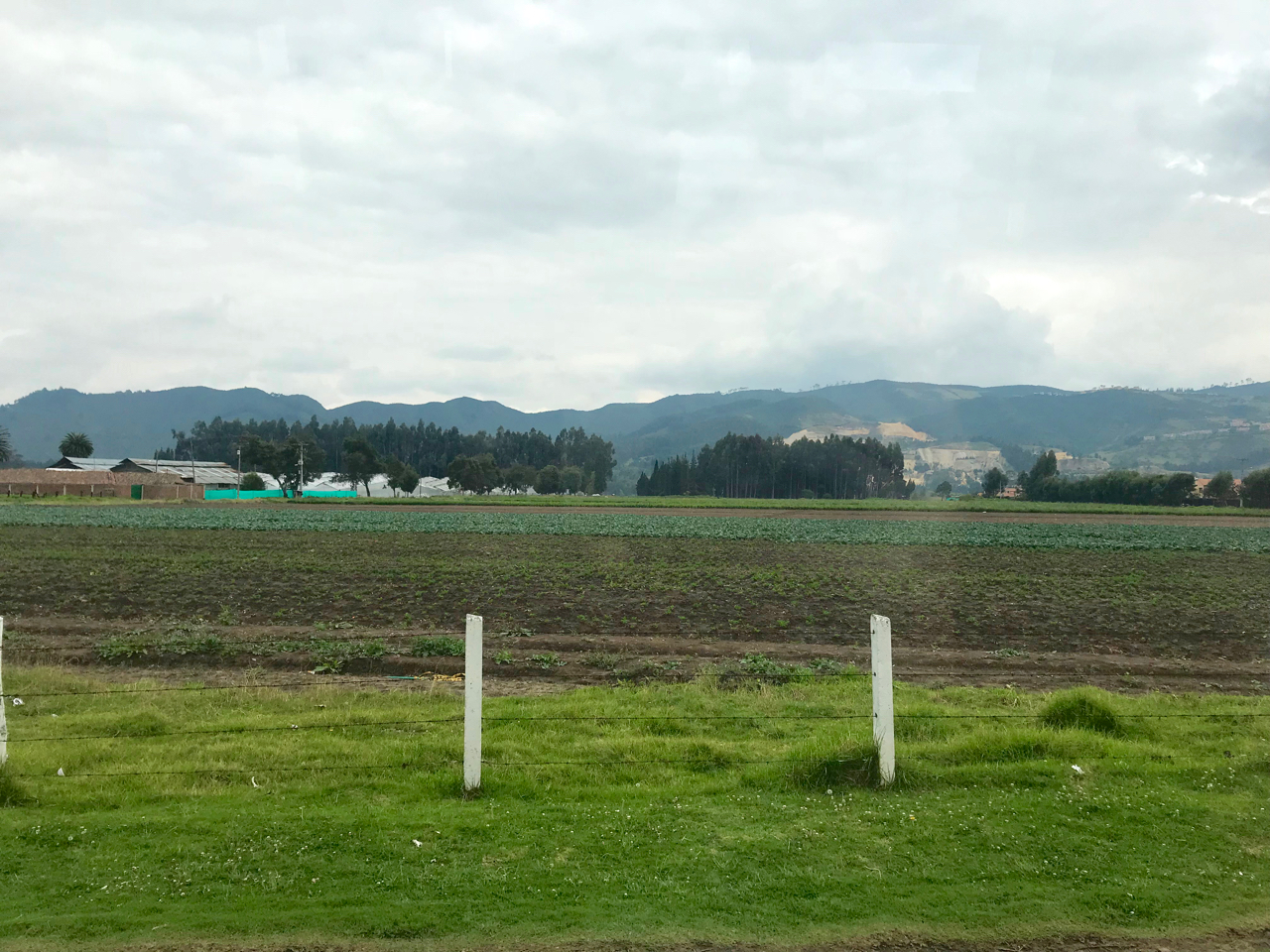 Colombian countryside with mountains and fields, view from bus from Bogota to Zipaquira