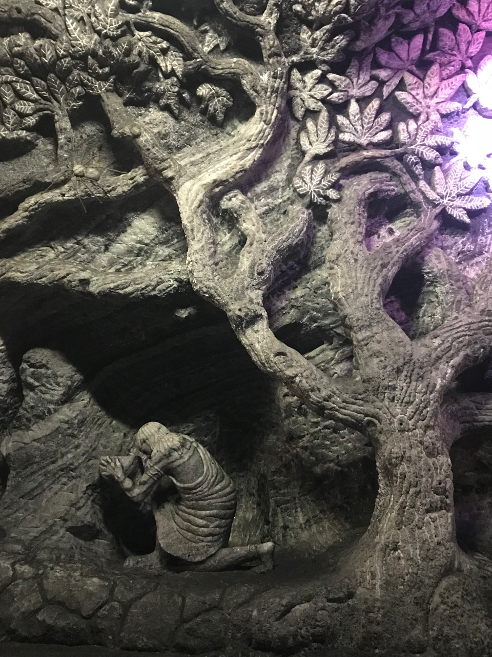 Tree and leaves carved into rock in Salt Cathedral Zipaquira