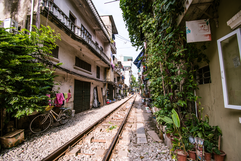 Hanoi train street tracks running through residential neighborhood